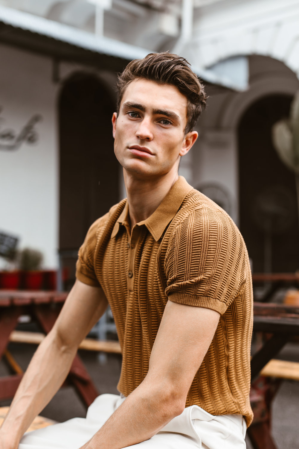 Luke wears textured weave polo shirt and baggy textured weave trousers from Zara