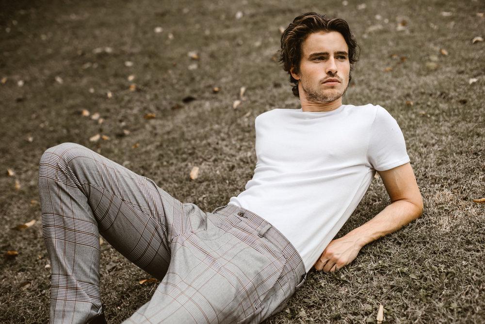 Luke K. wears white tee shirt and checked pants, both from Zara