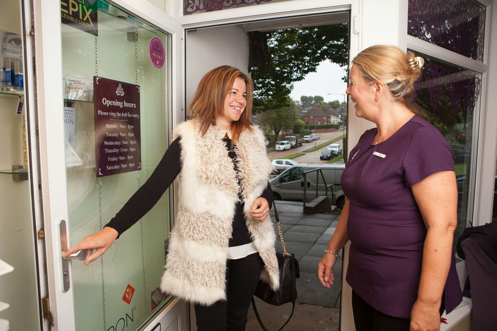 Rosie welcoming clients to salon