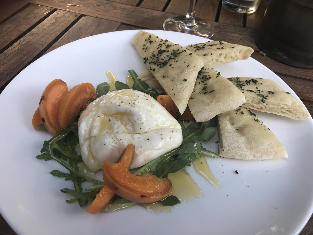Cuoco Seattle's burrata + herb flatbread with grilled apricot, and fennel honey