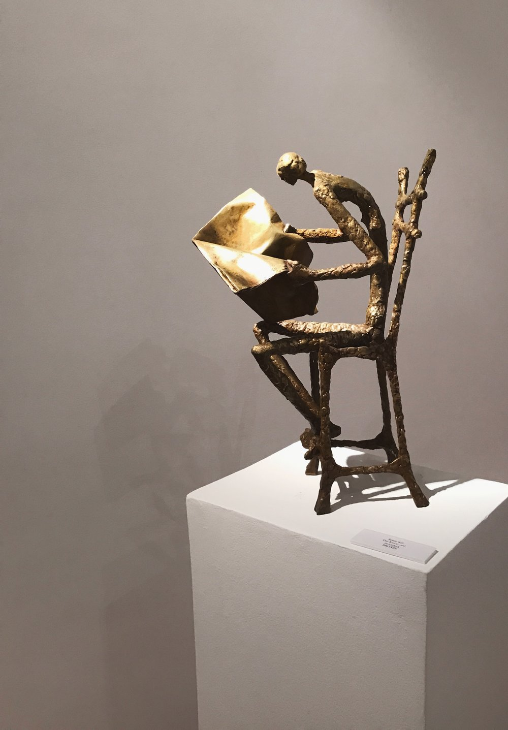 Nathan Doss   The News  Bronze  50 x 35 x 25 cm