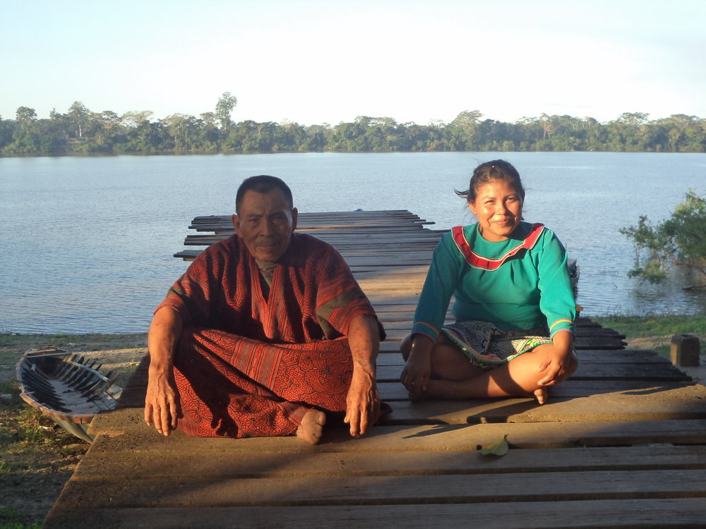 Maestro Leonardo and Maestra Lucia Sitting on the Pier overlooking the Ucayali River