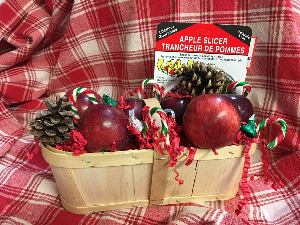 two quart basket of Apples - $25 3 lbs of your choice of Empire, Gala, McIntosh, Spy, Golden Delicious, Red Delicious Granny Smith, Ida Red, Russet, Flemish Beauty Pears or Bosc Pears. Premium Stainless Steel Apple Slicer Presented in a new wooden 2 quart basket decorated with Candy Canes, kisses and a bow
