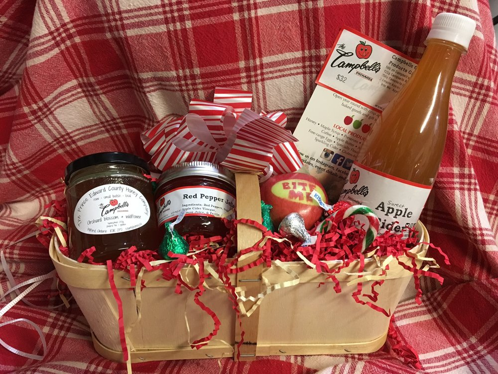 Campbell's in a two quart basket - $32 500ml Campbells Sweet Apple Cider 125g Campbells Red Pepper Jelly 250g Campbells Orchard Honey 1 'Bite Me' Apple Presented in a 2 Quart basket with candy canes and festive bow