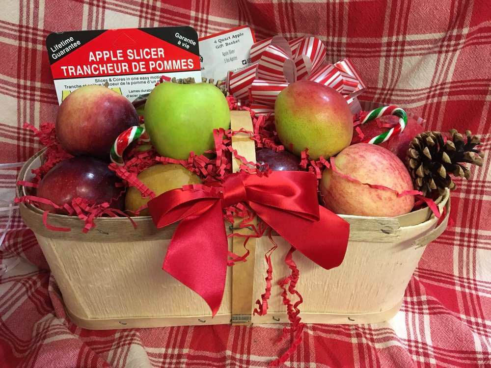 Four quart basket of Apples - $30 5 lbs of your choice Empire, Gala, McIntosh, Spy, Golden Delicious, Red Delicious, Granny Smith, Ida Red, Russet, Flemish Beauty Pears or Bosc Pears. 5 lbs of Honey Crisp available for an additional fee of $6 Premium Stainless-Steel Apple Slicer Presented in a new wooden 4 quart basket decorated with Candy Canes, kisses and a bow