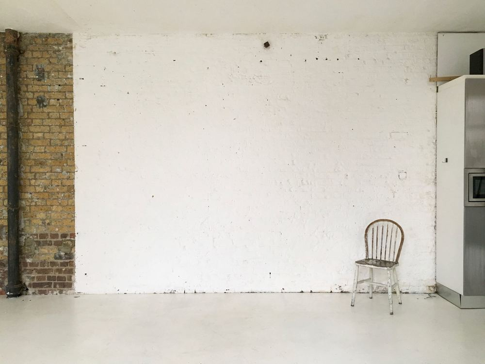 studio one white painted brick wall