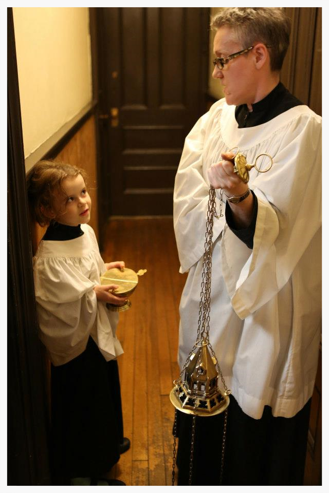Exceedingly adorable incense boat girl and thurifer preparing for worship at Saint Mary's