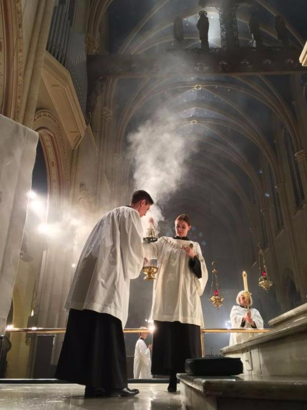Incense is added as Benedictus is sung during the Great Thanksgiving