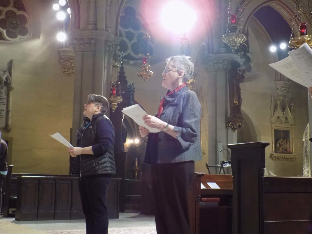 Mary Robison and Marie Rosseels were two of the ushers on Sunday, shown here during the Preparation of the Gifts.