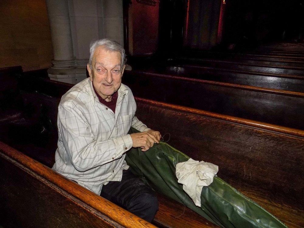 Dick Leitsch repairing pew cushions before Christmas begins.