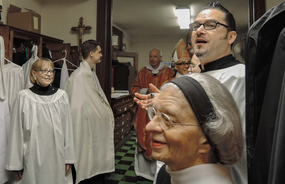 Many smiles in the sacristy before the Epiphany Mass begins.