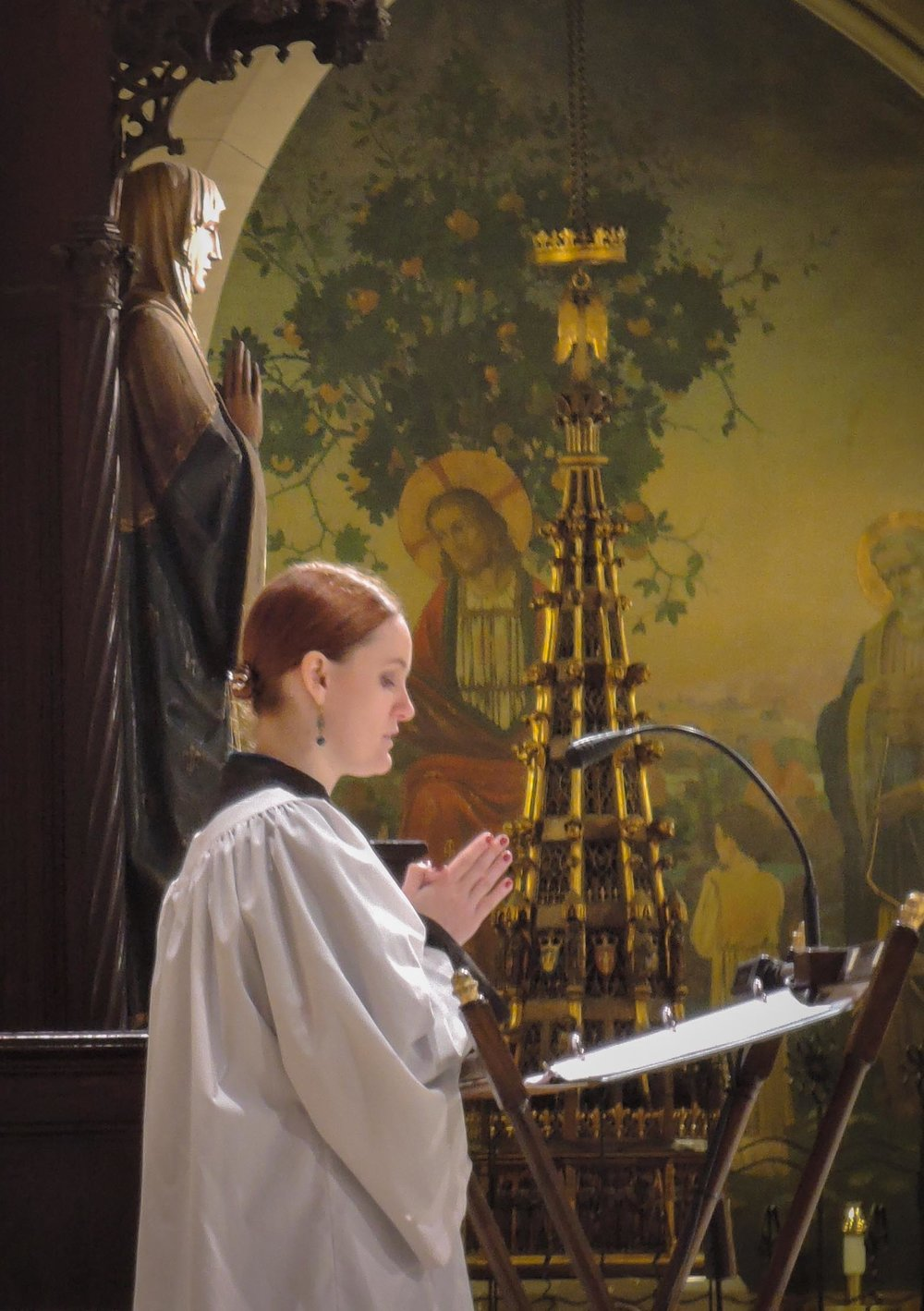 In the absence of a deacon, the prayers of the people are sung by a layperson, Grace Bruni.