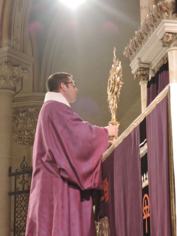 Deacon Matt Jacobson exposes the Host at Benediction.