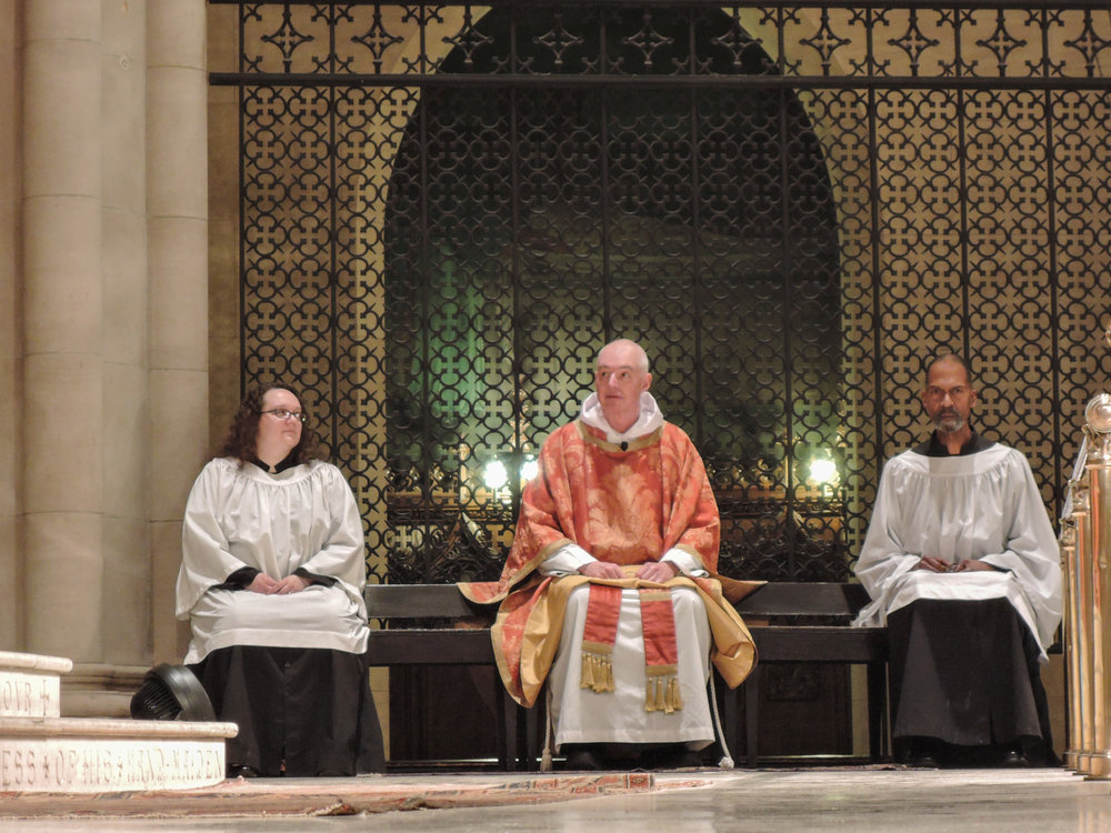 Reha Sterbin and Charles Carson were acolytes for the Mass.