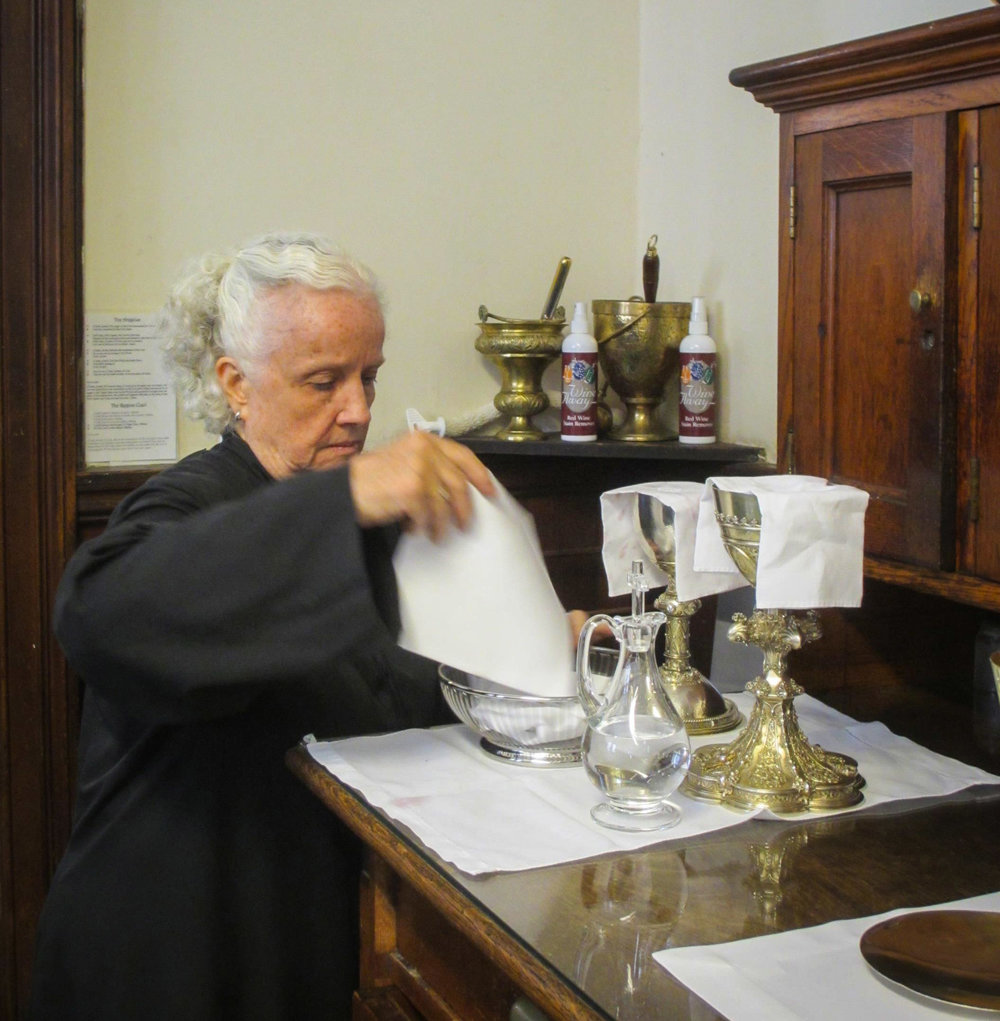 Julie Gillis washed vessels after Mass.