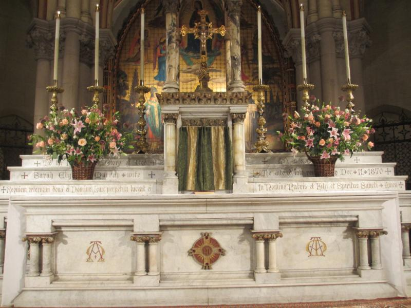 High Altar with the Book of Gospels in front of the tabernacle before Solemn Mass begins.