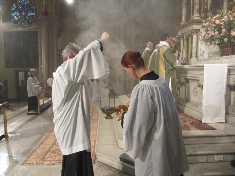 "More incense is added and, if needed, the altar book is turned to the right page at the singing of ""Blessed is he who comes in the name of the Lord."""