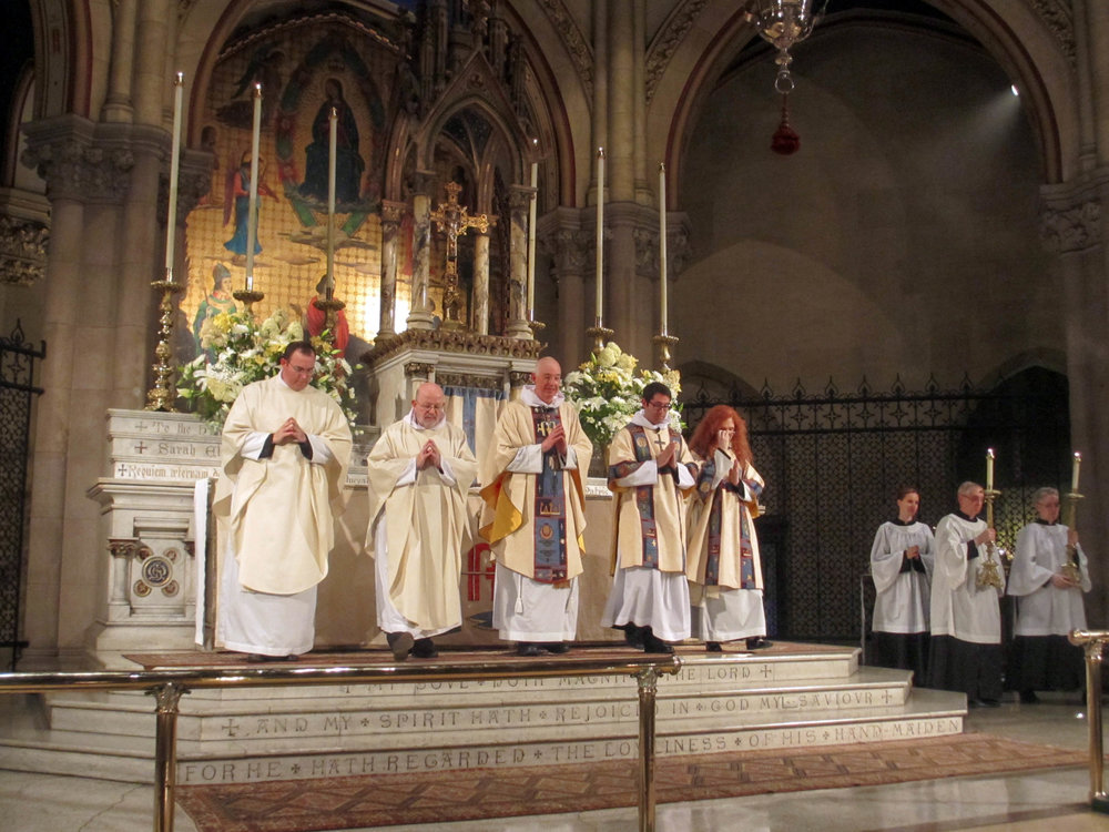 After the clergy reverence the altar,  the retiring procession forms.