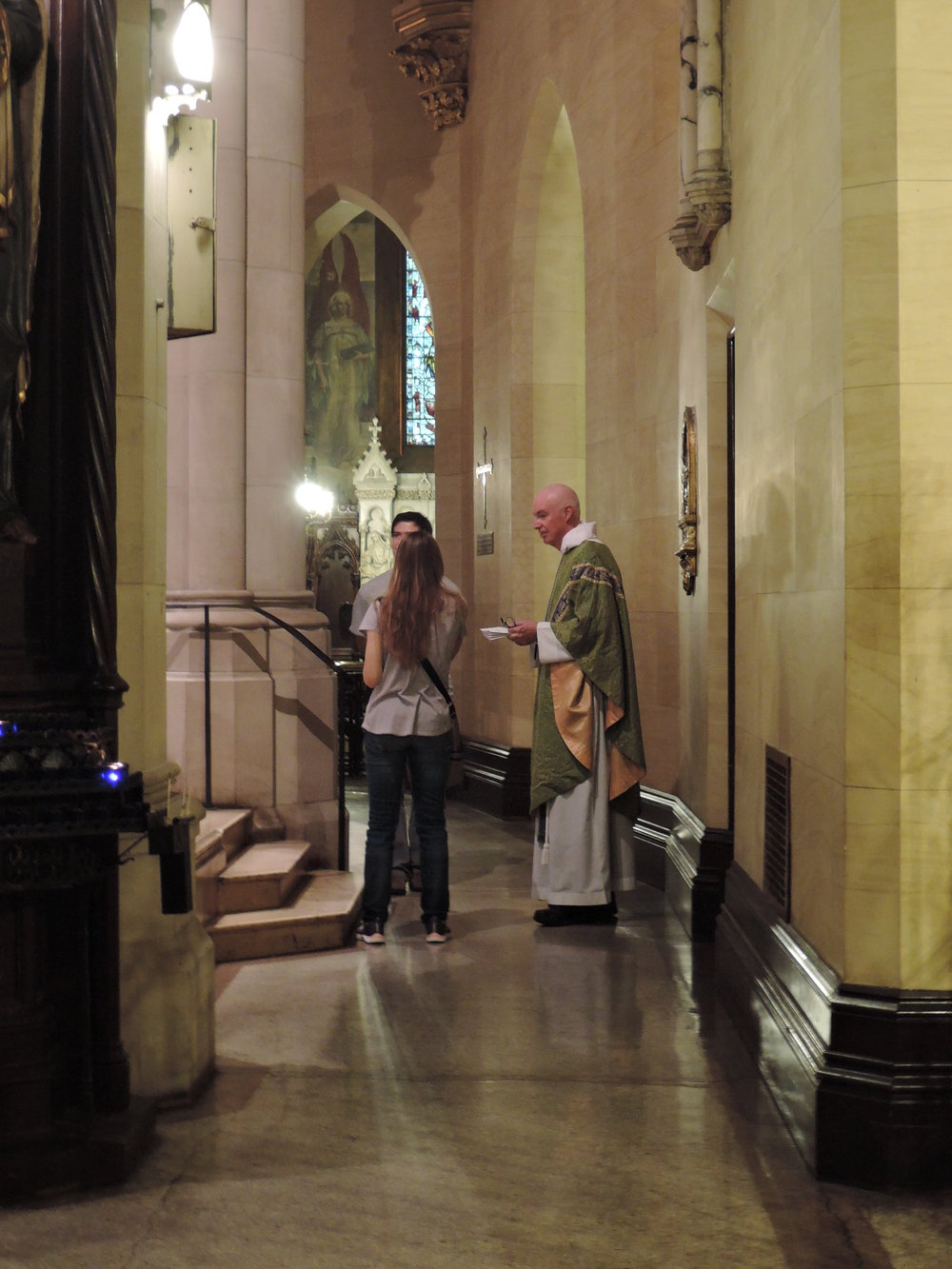 Father Gerth chats with       visitors after Mass on Sunday    .