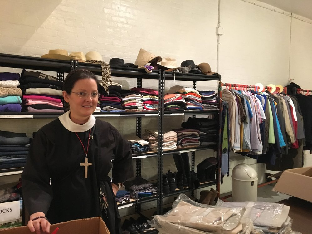 Sr. Monica Clare, C.S.J.B., at work in the Clothes Closet in the Mission House
