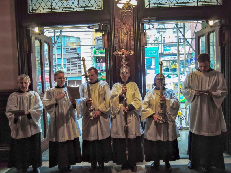 The acolytes sing the final hymn: a beautiful day on 46th Street