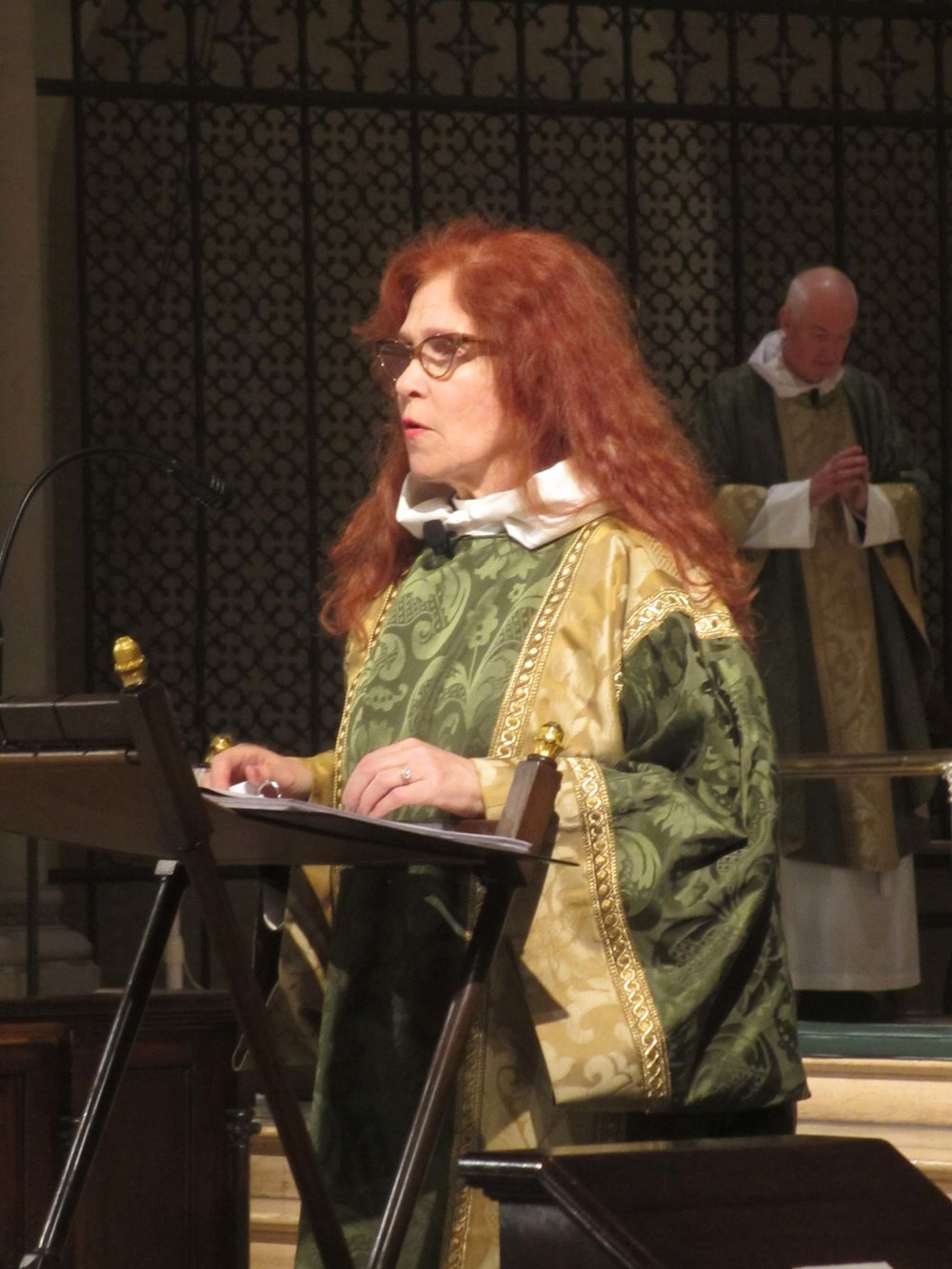 Deacon Rebecca Weiner Tompkins leads the Prayers of the People at Solemn Mass.
