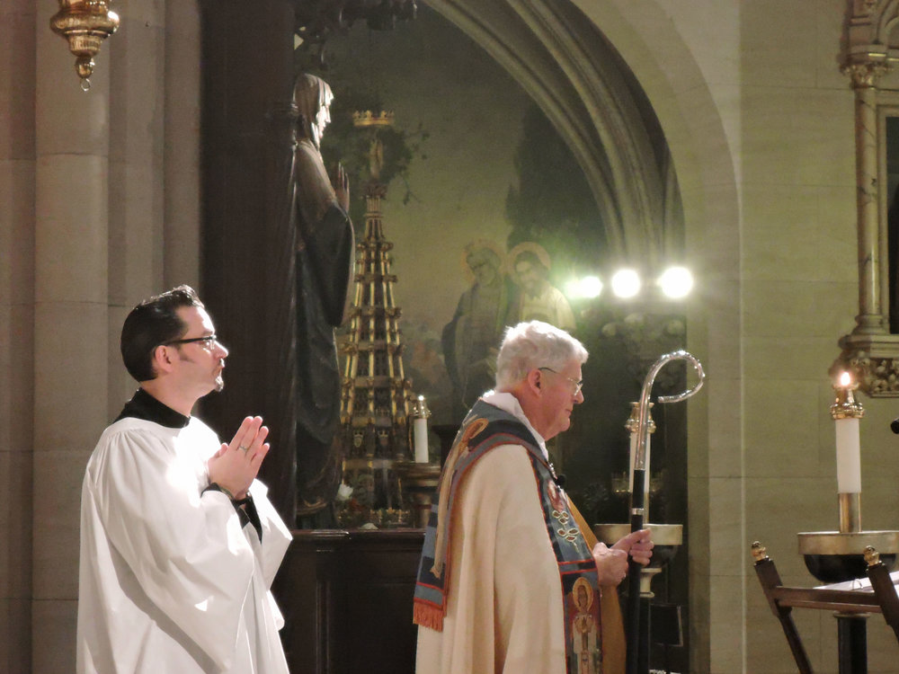 Bishop Griswold proceeds to the pulpit accompanied by Rick Miranda on the Feast of the Conception.  Photo by Sister Monica Clare, C.S.J.B.
