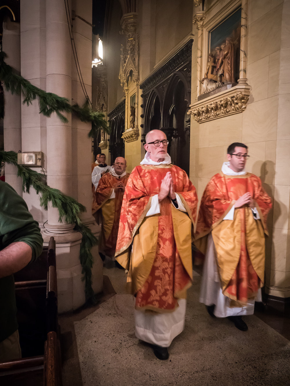 Father Paul Burrows and Father Matt Jacobson in procession at the Solemn Mass on Christmas Eve Photo by Ricardo Gomez