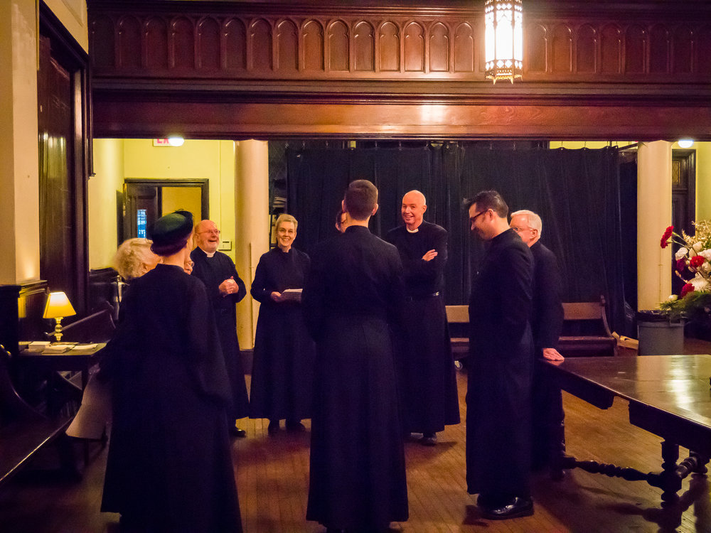 Many smiles on Christmas Eve among the servers and clergy   Photo by Ricardo Gomez