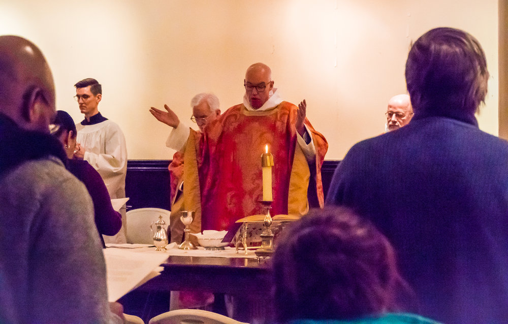 Mass was offered in Saint Joseph's Hall on Sunday, December 31, and on Monday, January 1, as there was no heat in the church.   Photo by Ricardo Gomez
