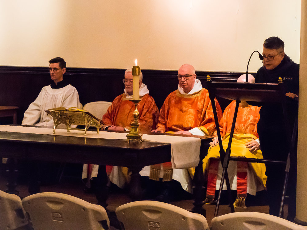 Mary Robison was lector and Brendon Hunter was server for the Mass on Sunday.  Photo by Ricardo Gomez
