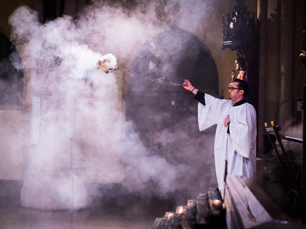 Ricardo Miranda served as thurifer at the Solemn Mass on Sunday.   Photo by Ricardo Gomez