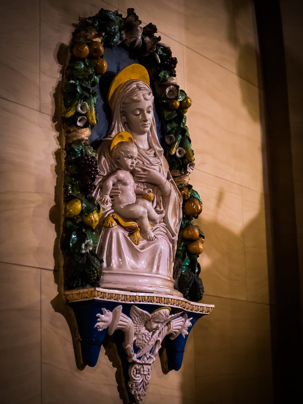 The Virgin & Child, 19th c.,   Della Robbia style,  gospel-side aisle  Photo by Ricardo Gomez
