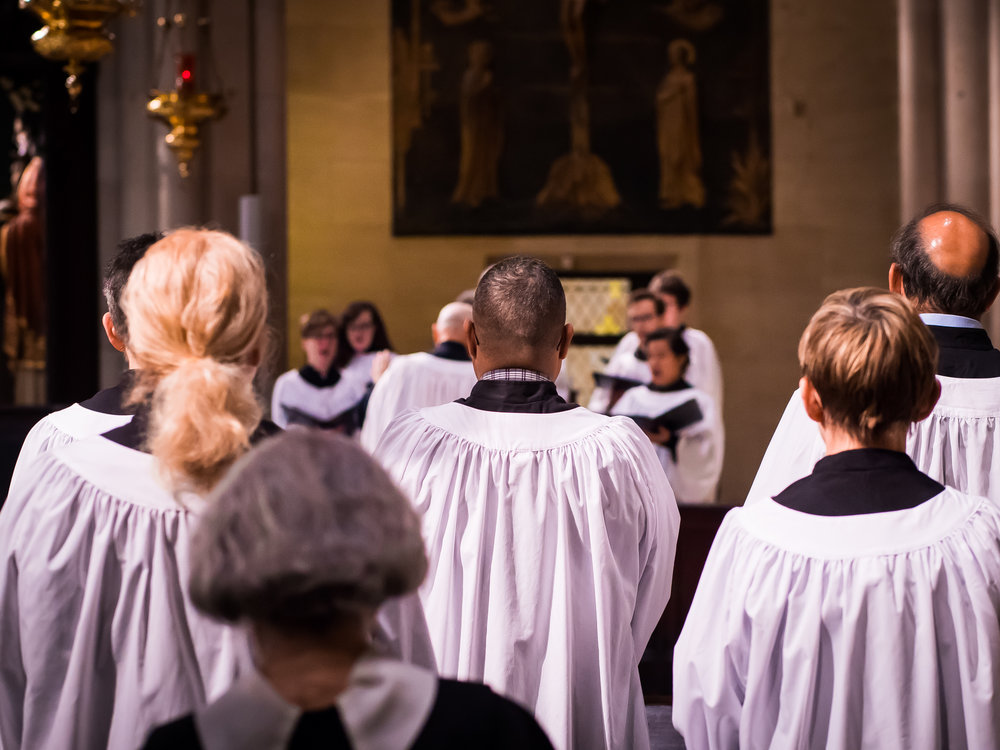 The acolytes, and sisters, listen to the choir at the Solemn Mass. At center, from the back: Luis Reyes serves as acolyte for the first time.  Photo by Ricardo Gomez