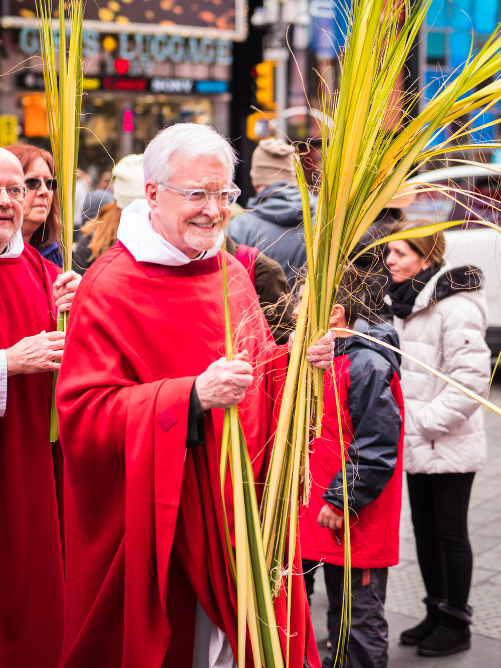 Palms are distributed by the congregation and clergy during the procession.  Photo by Ricardo Gomez