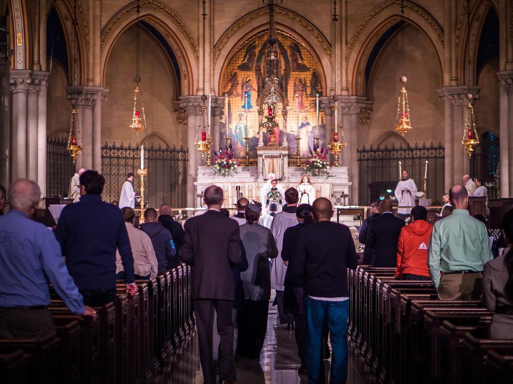 Representatives of the congregation bring the people's offerings of bread, wine, and money to the celebrant and deacon who will prepare the gifts for the Great Thanksgiving.  Photo by Ricardo Gomez