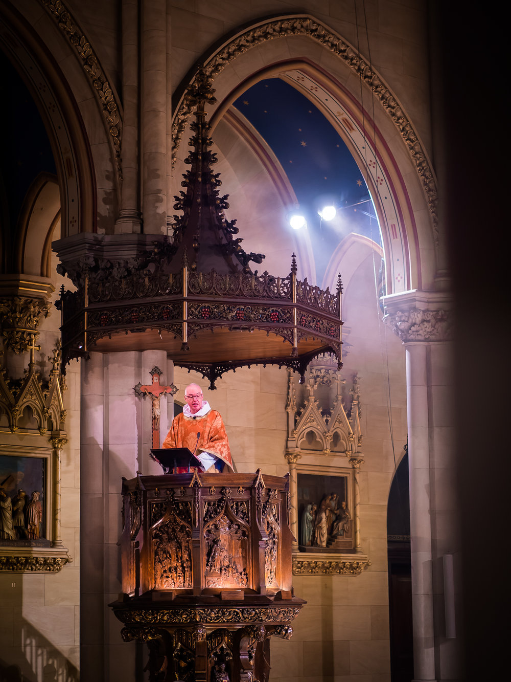 Father Gerth preaches from the pulpit carved by Johannes Kirchmayer.  Photo by Ricardo Gomez