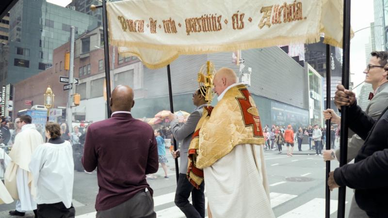 Crossing from the square on West 45th Street to return to the church.  Photo by Ricardo Gomez