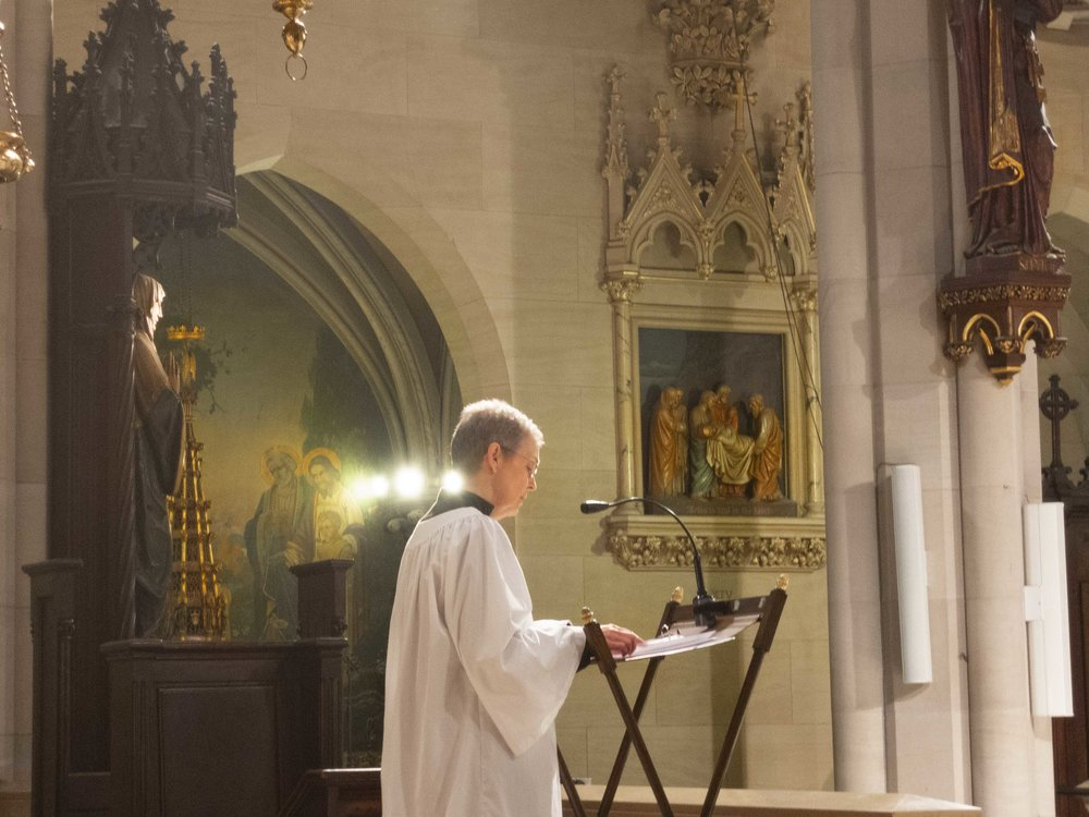 Parishioner MaryJane Boland stepped in at the last minute and read the lessons at the Solemn Mass on Sunday.    Photo by Sister Monica Clare, CSJB