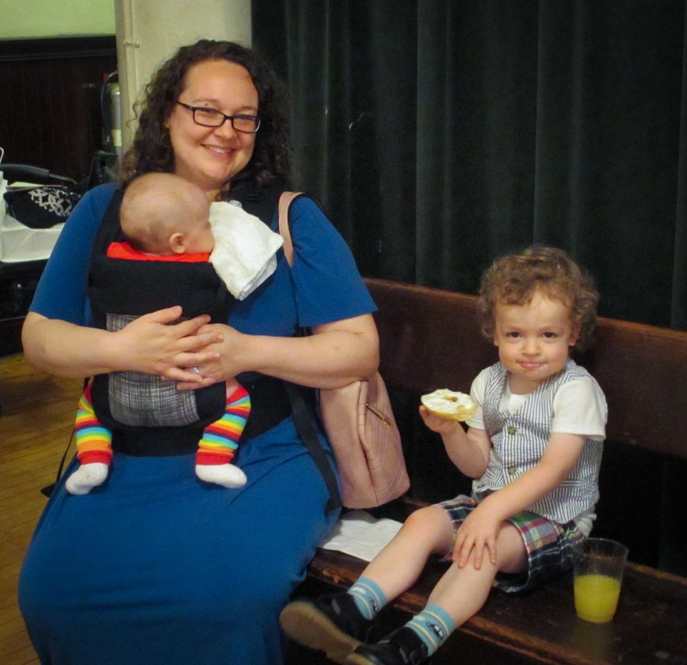 At Coffee Hour: Parishioner Reha Sterbin, with children Lilly and Jake, both working some excellent socks.  Photo by MaryJane Boland