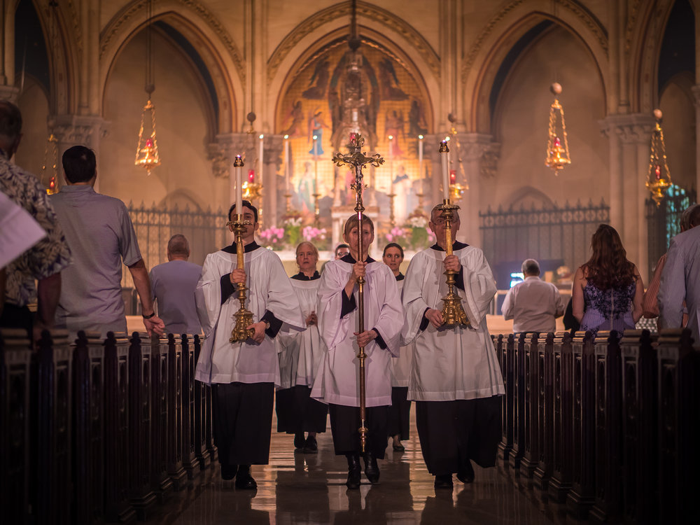 Our servers lead the retiring procession during the final hymn (and before the dismissal).  Photo by Ricardo Gomez