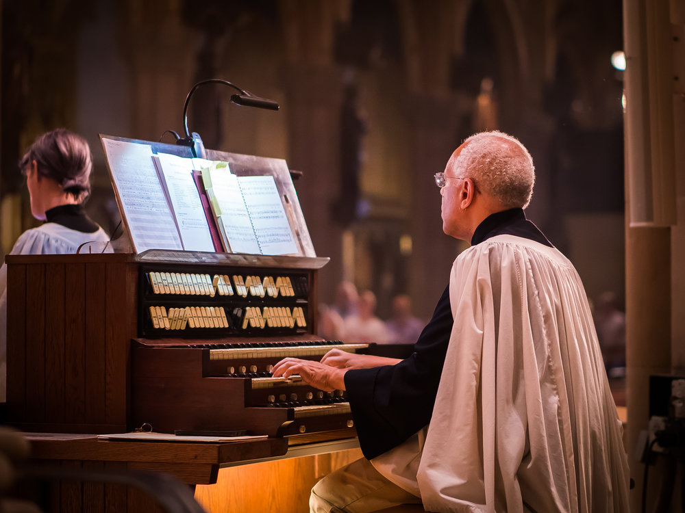 Dr. Hurd plays the first part of the service from the console in the chancel during the summer months.   Photo by Ricardo Gomez