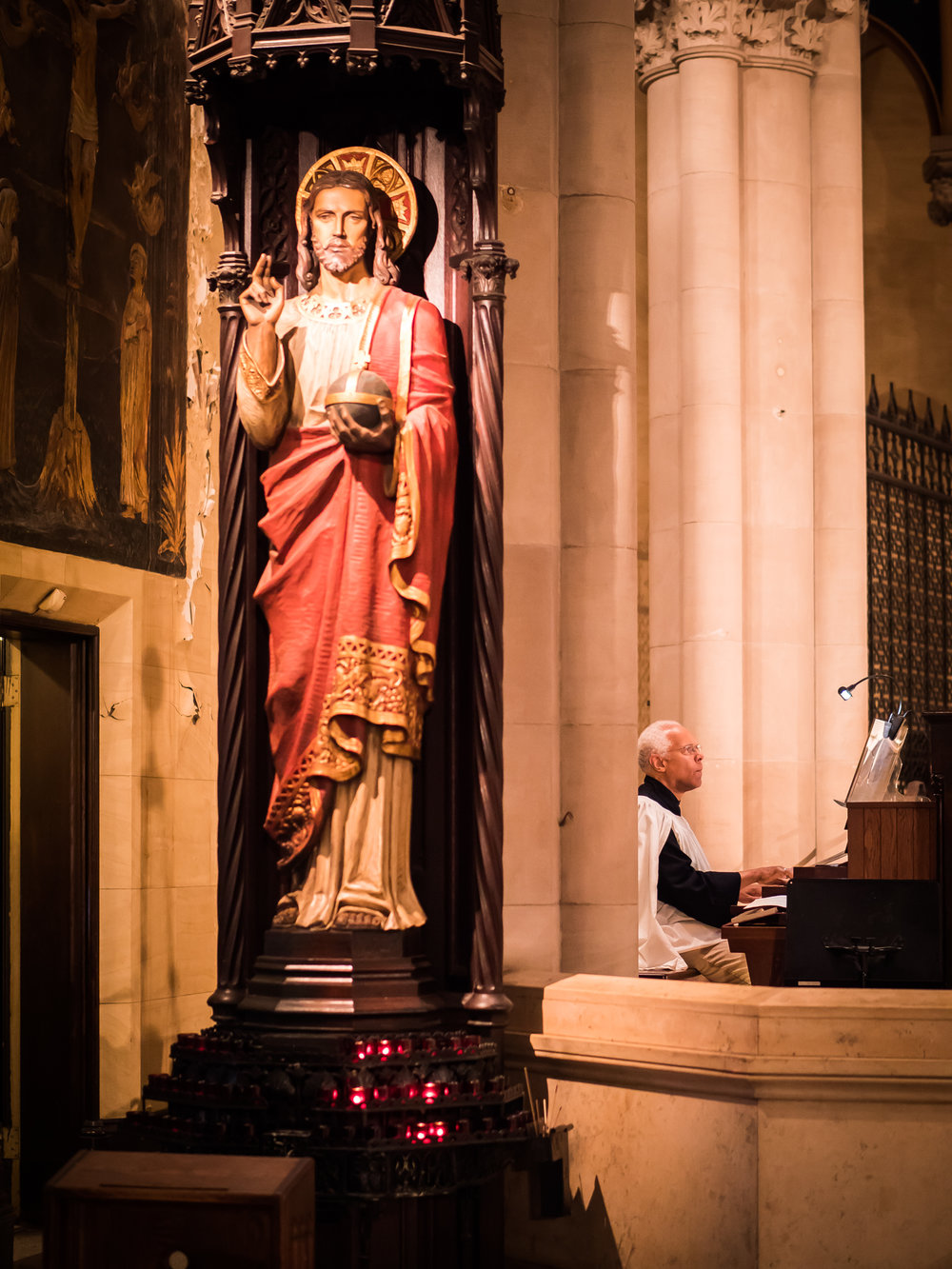 During the summer months, Dr. David Hurd plays the prelude before the Solemn Mass at the chancel console.   Foreground: The Shrine of Christ the King    by Johannes Kirchmayer (1860-1930)   Photo by Ricardo Gomez