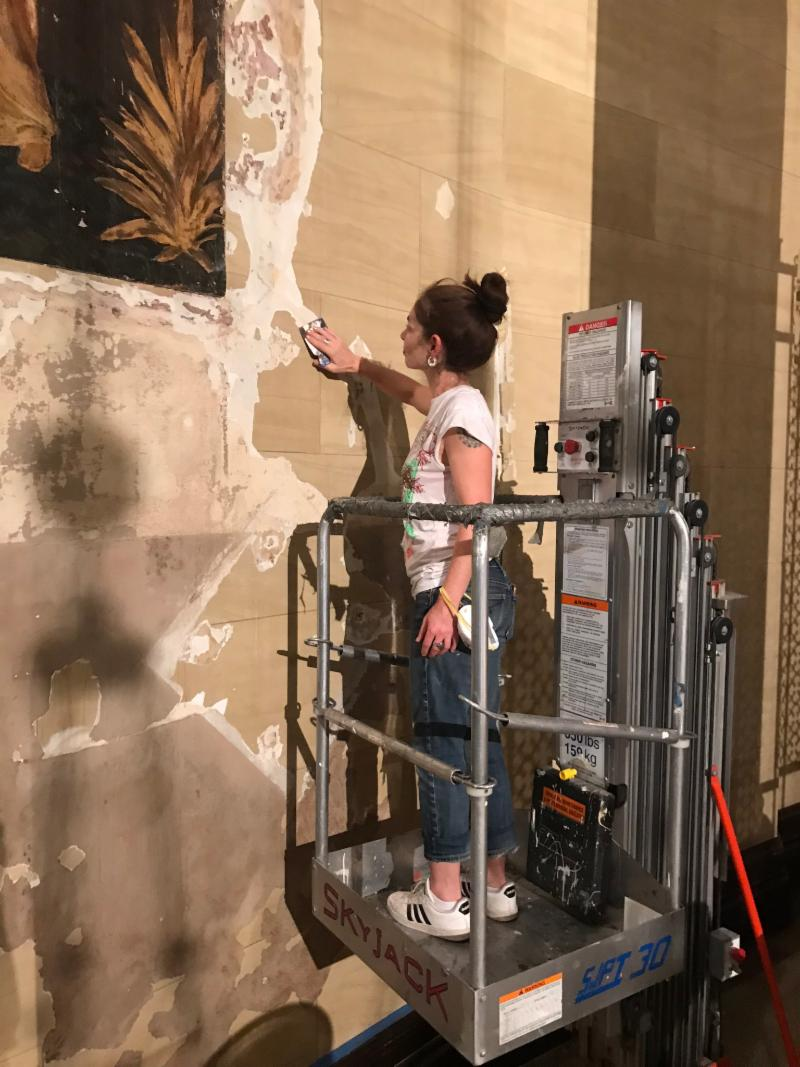 Masha Gittin, see-Painting, Inc., begins work on the bas relief.  Photo by the Rector