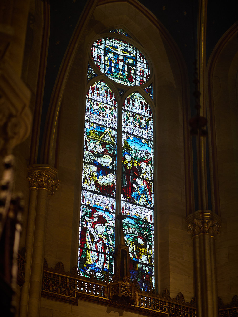 Central double-lancet window in apse: Roundel at top: The Crucifixion; Center: Adoration of the Shepherds; Bottom: Angel Appears to Shepherds  Photo by Ricardo Gomez
