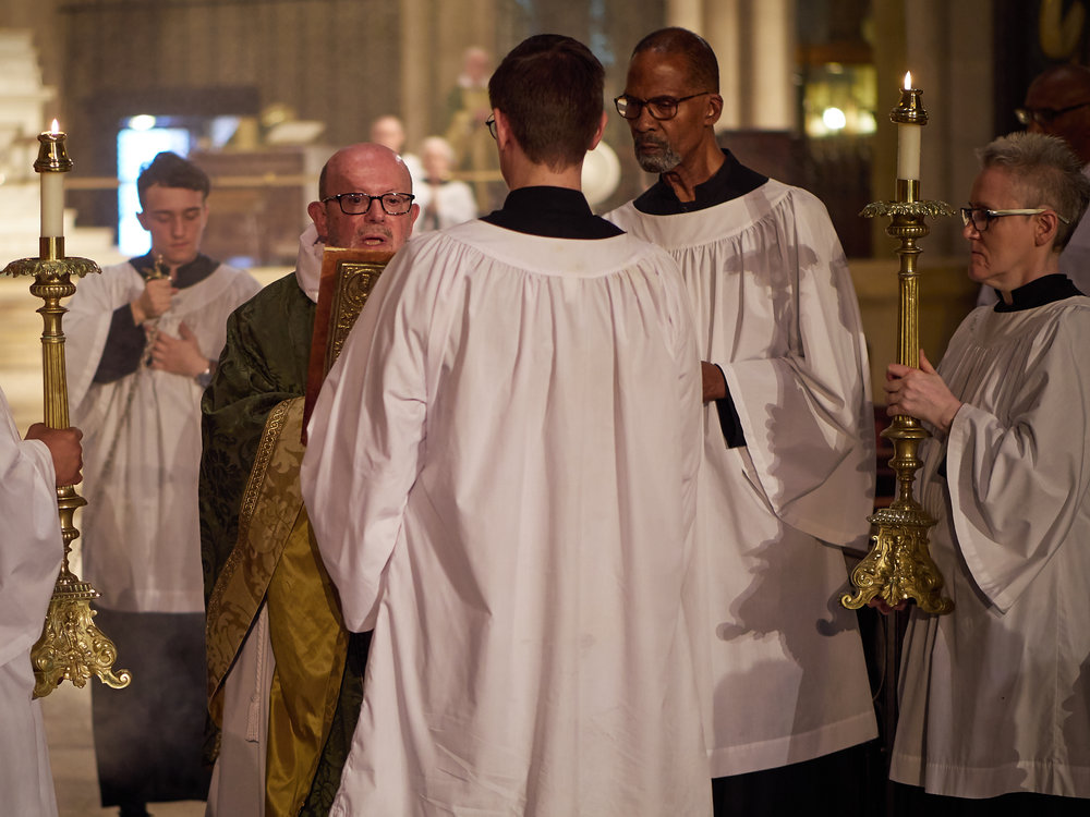 The gospel is proclaimed: (l. to r.) Rami Eskelin, Fr. Jay Smith, Brendon Hunter & Charles Carson  Photo by Ricardo Gomez