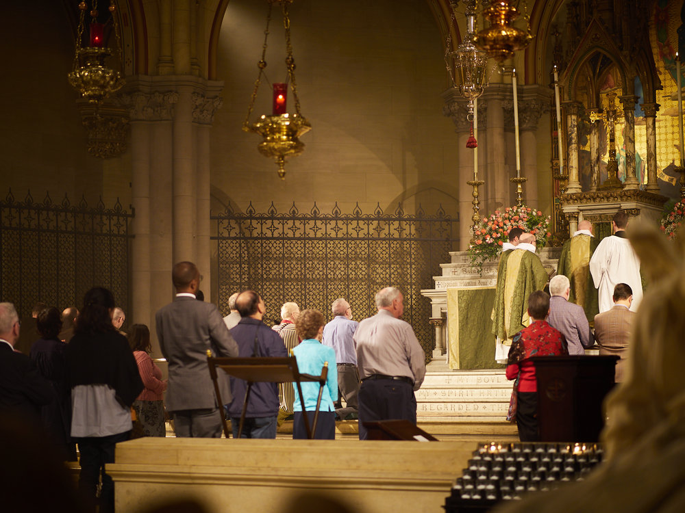 The moment before the ministers of the Sacrament deliver the Sacrament to the congregation. Other servers behind the altar rail will receive from the ministers who will carry the Sacrament persons in the congregation and to the organ gallery.    Photo by Ricardo Gomez