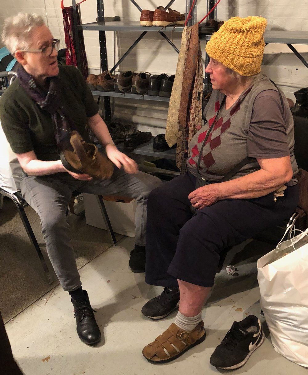 Two Saint Mary's parishioners have a serious discussion about footwear at the Drop-in Day.   Photo: Brother Thomas, SSF