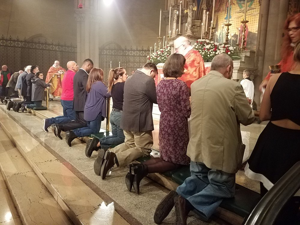 The Ministration of Communion.   Photo by John Delves