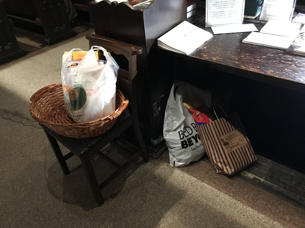 Gifts of food for Saint Clement's Church Pantry are received at all Sunday services.   Photo by Br. Damien SSF